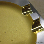 A diffused high efficiency Laser Gold meant to create a Lambertian effect in the cup of the device.